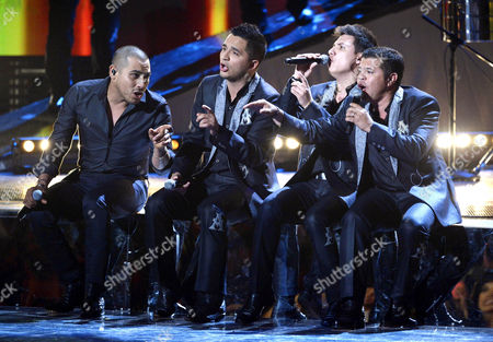 Stock Image of Singers Espinoza Paz Josi Isidro Beltran Cuen Vincen Melendres Garcia and Jorge Luis Medina Ramos of La Arrolladora Banda El Limon Perform During the 15th Annual Latin Grammy Awards at the Mgm Grand in Las Vegas Nevada Usa 20 November 2014 Latin Grammy Awards Recognize Artistic And/or Technical Achievement not Sales Figures Or Chart Positions and the Winners Are Determined by the Votes of Their Peers-the Qualified Voting Members of the Academy United States Las Vegas