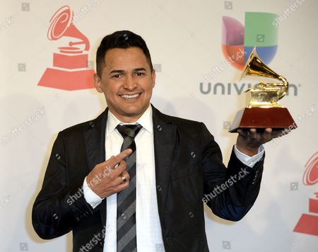 Singer Jorge Celedon Holds the Latin Grammy For Best Cumbia/vallenato Album at the 15th Annual Latin Grammy Awards at the Mgm Grand in Las Vegas Nevada Usa 20 November 2014 Latin Grammy Awards Recognize Artistic And/or Technical Achievement not Sales Figures Or Chart Positions and the Winners Are Determined by the Votes of Their Peers-the Qualified Voting Members of the Academy United States Las Vegas