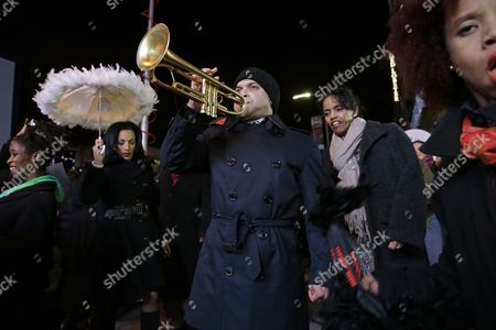The New Orleans Jazz Orchestra Lead by Us Jazz Trumpeter Irvin Mayfield Jr (c) March to the Apollo Theater to Induct Jazz Great Louis Armstrong Into It's 'Walk of Fame' in New York New York Usa 07 November 2014 the Ceremony Starts the New Orleans to Harlem Jazz Weekend United States New York