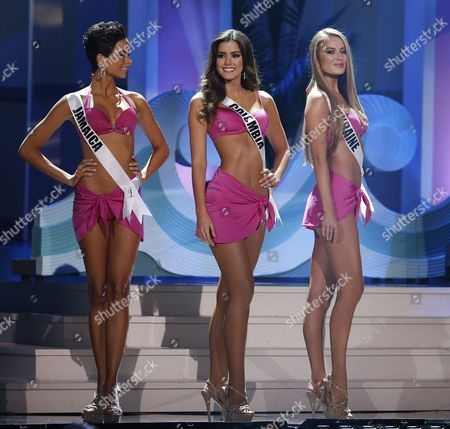 Stock Photo of (l-r) Miss Jamaica Kaci Fennell Miss Colombia Paulina Vega and Miss Ukraine Diana Harkusha on Stage During the Swimsuit Competition at the 2014 Miss Universe Final at the Fiu Arena in Miami Usa 25 January 2015 United States Miami