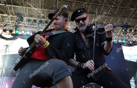 Boris Pelekh (l) and Sergey Ryabtsev (r) of the Gypsy Punk Band Gogol Bordello Perform at the Lawn Outdoor Concert at White River State Park in Indianapolis Indiana Usa 23 June 2015 United States Indianapolis