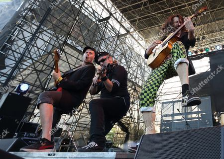 Boris Pelekh (l) Sergey Ryabtsev (c) and Eugene Huetz of the Gypsy Punk Band Gogol Bordello Performs at the Lawn Outdoor Concert at White River State Park in Indianapolis Indiana Usa 23 June 2015 United States Indianapolis