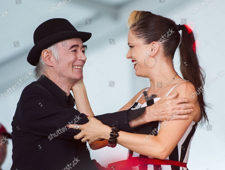 Stock Image of Irish Dj Author Photographer and Musician Bp Fallon Left Embraces Irish Musician Imelda May Right After He Introduced May at the 2014 Austin City Limits Music Festival at Zilker Park in Austin Texas Usa on 12 October 2014 United States Austin