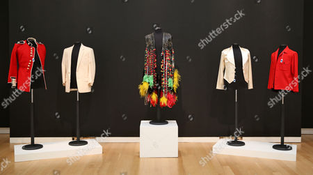 Stock Photo of Outfits Belonging to Musicians Michael Jackson Elvis Presley Sly Stone and Jimmy Page Are on Display As Part of the Show 'A Rock and Roll History: Presley to Punk' at Sotheby's Auction House in New York New York Usa 20 June 2014 the Auction Will Take Place on 24 June United States New York