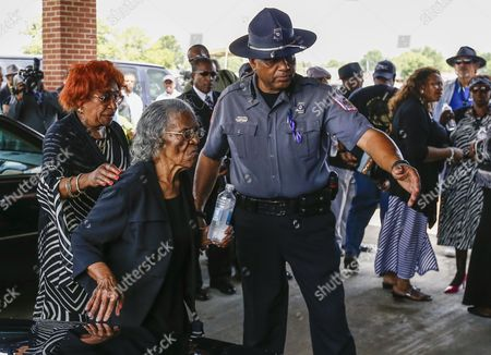 A Mississippi Law Enforcement Officer Escorts Family Members to Funeral Services For Blues Legend B B King at Bell Grove Missionary Baptist Church in Indianola Mississippi Usa 30 May 2015 King Died 14 May While in Home Hospice Care in His Home in Las Vegas Nevada Usa and Will Be Buried in at the B B King Museum United States Indianola