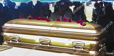 Roses Are Placed on the Casket Containing the Body of Blues Great B B King at Graveside Funeral Services at the B B King Museum in Indianola Mississippi Usa 30 May 2015 King Died 14 May While in Home Hospice Care in His Home in Las Vegas Nevada Usa United States Indianola