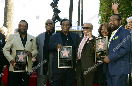 Stock Image of Us Singer Stevie Wonder (2 L) Berry Gordy (3r) Mary Wilson (2r) From the Supreme Participate As Us Songwriters and Producers Eddie Holland (l) Lamont Dozier (3l) and Brian Holland (r) Are Honored with a Star on the Hollywood Walk of Fame in Hollywood California Usa 13 February 2015 This is the 2 543rd Star on the Hollywood Walk of Fame United States Hollywood
