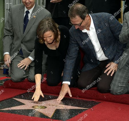 The Younger Siblings of Us Singer Janis Joplin Michael (r) and Laura Joplin (c) Touch Their Sister's Star During a Ceremony Honoring Her Posthumously with a Star on the Hollywood Walk of Fame in Hollywood California Usa 04 November 2013 the Iconic Singer Died in 1970 and Received the 2 510st Star on Hollywood Boulevard United States Hollywood