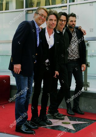 Australian Singer Rick Springfield (2-r) Stands with Us Actor Doug Davidson (l) Us Singer Richard Marx (2-l) and Canadian Actor Jason Thompson (r) During a Ceremony Honoring Him on the Hollywood Walk of Fame in Hollywood California Usa 09 May 2014 This is the 2 535th Star on the Hollywood Walk of Fame United States Hollywood