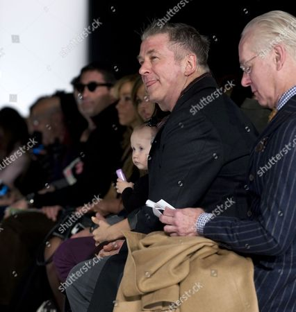 Stock Photo of Us Actor Alec Baldwin (c) and His Baby Daughter Carmen Gabriela Watch the Carmen Marc Valvo Show As Project Runway Host Tim Gunn (r) Reads the Show Program During the Mercedes-benz Fashion Week in New York New York Usa 15 February 2015 the Fall 2015 Collections Are Presented From 12 to 19 February United States New York
