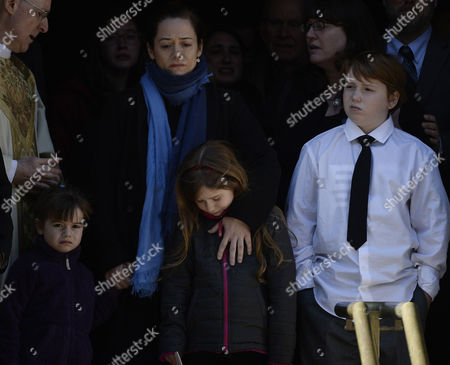 Stock Image of Long Time Girlfriend of Us Actor Phillip Seymour Hoffman Mimi O'donnel (2l) with Their Children Tallulah (l) Willa (2r) and Cooper Alexander (r) Leave the Funeral Mass For Hoffman at St Ignatius Church in New York New York Usa 07 February 2014 Hoffman 46 Died 02 February From a Suspected Drug Overdose United States New York