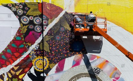 Stock Photo of Painters Work on Finishing a Mural Titled 'Seven Moons Junction' by Us Artist Shinique Smith Over Dewey Square on the Rose Kennedy Greenway in Boston Massachusetts Usa 17 September 2014 Boston's Museum of Fine Arts is Currently Showing the Painting by Smith 'Seven Moons' That Has Inspired This 70 by 76 Foot (21 3 X 23 1 Meter) Mural United States Boston