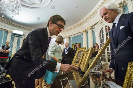 Stock Photo of Peter Wittig (l) the German Ambassador to the United States Examines Art Work Missing Since World War Ii Being Returned to Germany While Monuments Men Foundation Chairman Robert Edsel (r) Looks on at the Us State Department in Washington Dc Usa 05 May 2015 the Five Paintings Will Be Restituted by the Monuments Men Foundation to the Federal Republic of Germany United States Washington