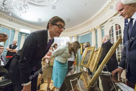 Stock Image of Peter Wittig (l) the German Ambassador to the United States Examines Paintings Missing Since World War Ii Being Returned to Germany While Monuments Men Foundation Chairman Robert Edsel (r) Looks on at the Us State Department in Washington Dc Usa 05 May 2015 the Five Paintings Will Be Restituted by the Monuments Men Foundation to the Federal Republic of Germany United States Washington