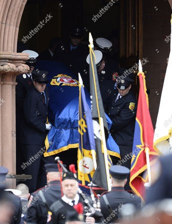 Pall Bearers Carry the Casket out of the Church of Saint Patrick Following the Funeral For Fallen Boston Fire Lt Edward Walsh in Watertown Massachusetts Usa 02 April 2014 Walsh and Firefighter Michael Kennedy Were Killed in a Fire in the Back Bay Section of Boston 26 March 2014 United States Watertown