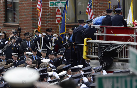 Boston Fire Fighters Remove the Casket From Engine 33 During the Funeral Procession For Fallen Boston Fire Lt Edward Walsh in Watertown Massachusetts Usa 02 April 2014 Walsh and Firefighter Michael Kennedy Were Killed in a Fire in the Back Bay Section of Boston on 26 March 2014 United States Watertown