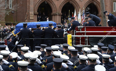 Pall Bearers Lift the Casket of Fallen Boston Fire Lt Edward Walsh Onto the Boston Fire Engine 33 Outside of the Church of Saint Patrick Following His Funeral in Watertown Massachusetts Usa 02 April 2014 Walsh and Firefighter Michael Kennedy Were Killed in a Fire in the Back Bay Section of Boston 26 March 2014 United States Watertown