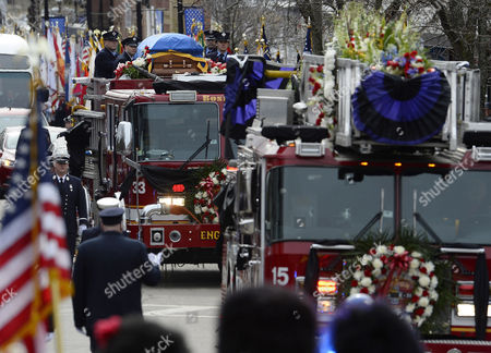 Boston Fire Engine 33 and Ladder 15 Transport the Casket During the Funeral Procession For Fallen Boston Fire Lt Edward Walsh in Watertown Massachusetts Usa 02 April 2014 Walsh and Firefighter Michael Kennedy Were Killed in a Fire in the Back Bay Section of Boston on 26 March 2014 United States Watertown