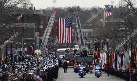 Firefighters Stand at Attention As Engine 33 and Ladder 15 Transport the Casket During the Funeral Procession For Fallen Boston Fire Lt Edward Walsh in Watertown Massachusetts Usa 02 April 2014 Walsh and Firefighter Michael Kennedy Were Killed in a Fire in the Back Bay Section of Boston on 26 March 2014 United States Watertown