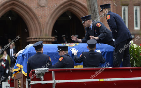 Pall Bearers Secure the Casket of Fallen Boston Fire Lt Edward Walsh Onto the Boston Fire Engine 33 Outside of the Church of Saint Patrick Following His Funeral in Watertown Massachusetts Usa 02 April 2014 Walsh and Firefighter Michael Kennedy Were Killed in a Fire in the Back Bay Section of Boston 26 March 2014 United States Watertown