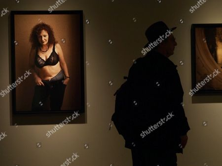 A Picture Made Available on 12 January 2014 Shows a Visitor Walking Next to a Photograph by Us Photographer Nan Goldin 'Nan Goldin in My Hall Berlin' Displayed at the Nan Goldin: Nine Self-portraits Exhibit at the Fraenkel Gallery in San Francisco California Usa 09 January 2014 the Exhibit Runs Through 08 March 2014 United States San Francisco