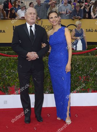 Us Actor Robert Duvall (l) and His Wife Argentine Actress Luciana Pedraza (r) Arrive at the 21st Annual Screen Actors Guild Awards Ceremony at the Shrine Auditorium in Los Angeles California Usa 25 January 2015 United States Los Angeles