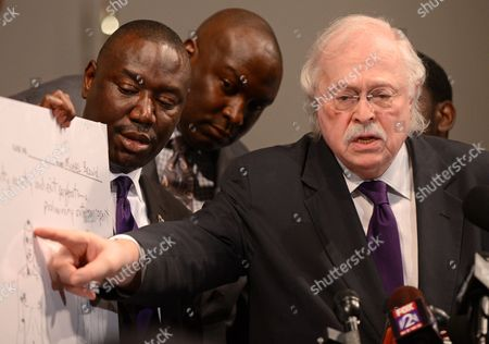 Stock Photo of Dr Michael Baden (r) who Conducted an Independent Autopsy at the Request of Michael Brown's Family Discusses where Brown was Shot During a Press Conference at the Greater St Marks Family Church in Ferguson Missouri Usa 18 August 2014 Standing Next to Him Are Brown Family Attorneys Benjamin Crump Left and Daryl Parks United States St Louis