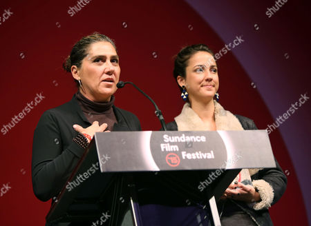 Stock Photo of Brazilian Director Anna Muylaert (l) and Actress Camila Mardila (r) Accept the World Cinema Dramatic Special Jury Award For Acting in 'The Second Mother' at the 2015 Sundance Film Festival Awards Night in Park City Utah Usa 31 January 2015 the Festival Runs From 22 January to 01 February 2015 United States Park City