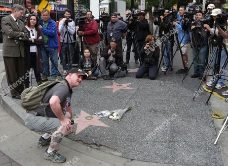 A Man Poses For a Photo at Leonard Nimoy's Star on the Hollywood Walk of Fame in Hollywood California Usa 27 February 2015 Leonard Nimoy the Actor who Played Mr Spock on the 1960s Us Television Series Star Trek is Dead Confirmed the Actor's Agent on 27 February the 83-year-old Died at His Home in Los Angeles the Cause of Death was End-stage Chronic Obstructive Pulmonary Disease (copd) Nimoy Acted in Numerous Movies and Television Series But was Best Known For His Portrayal of Spock in the Star Trek Tv Show and Movies where the Character Eventually was Promoted to Commander Though the Series Which Debuted in 1966 Ran Only Three Seasons the Role of the Unemotional Pointy-eared Vulcan Made Nimoy a Folk Hero United States Hollywood