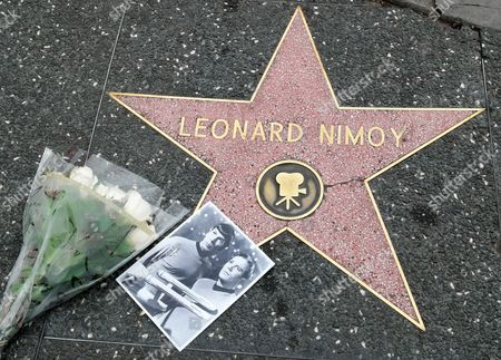 A Photo of Leonard Nimoy in Character As Spock on 'Star Trek' and Flowers Are Pictured at Leonard Nimoy's Star on the Hollywood Walk of Fame in Hollywood California Usa 27 February 2015 Leonard Nimoy the Actor who Played Mr Spock on the 1960s Us Television Series Star Trek is Dead Confirmed the Actor's Agent on 27 February the 83-year-old Died at His Home in Los Angeles the Cause of Death was End-stage Chronic Obstructive Pulmonary Disease (copd) Nimoy Acted in Numerous Movies and Television Series But was Best Known For His Portrayal of Spock in the Star Trek Tv Show and Movies where the Character Eventually was Promoted to Commander Though the Series Which Debuted in 1966 Ran Only Three Seasons the Role of the Unemotional Pointy-eared Vulcan Made Nimoy a Folk Hero United States Hollywood