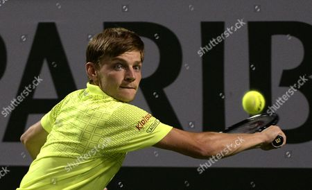 David Goffin From Belgium Returns to Nikolay Davydenko From Russia During Their Men's Single Match at the Bnp Paribas Open Tennis Tournament in Indian Wells California Usa 07 March 2014 United States Indian Wells