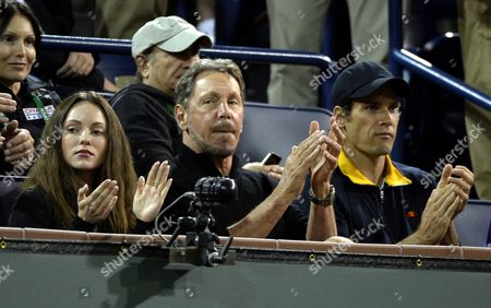 Oracle Co-founder and Ceo Larry Ellison (c) Sits with Ukrainian Actress Nikita Kahn (l) and German Tennis Player Tommy Haas Attend the Bnp Paribas Open Tennis in Indian Wells California Usa 45 March 2014 United States Indian Wells
