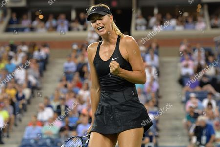 Maria Sharapova of Russia Reacts to Winning a Point Against Maria Kirilenko of Russia During the 2014 Us Open Tennis Championship at the Usta National Tennis Center in Flushing Meadows New York Usa 25 August 2014 the Us Open Runs Until 08 September a 15-day Schedule United States Flushing Meadows