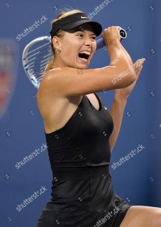 Maria Sharapova of Russia Hits a Return to Maria Kirilenko of Russia During the 2014 Us Open Tennis Championship at the Usta National Tennis Center in Flushing Meadows New York Usa 25 August 2014 the Us Open Runs Until 08 September a 15-day Schedule United States Flushing Meadows