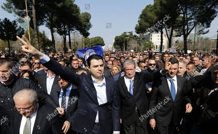 Stock Image of Lulzim Basha (c-l) Leader of Opposition Democratic Party of Albania and Sali Berisha (c-r) Former Prime Minister Lead Some Thousands Protesters in the Main Boulevard of Tirana Albania 12 March 2015 Some Thousands Protesters Gather to Protest Against the Government and Asking the Resignation of Albanian Speaker of the Parliament Ilir Meta After Two Mp Denounce Him of Allegedly Organizing to Kill Them Albania Tirana