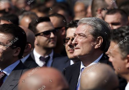 Former Albanian President Prime Minister and Historic Leader of Democratic Party of Albania Sali Berisha Listens to Lulzim Basha (not Pictured) Leader of Opposition Democratic Party of Albania As He Addresses Some Thousands Protesters in the Main Boulevard of Tirana Albania 12 March 2015 Some Thousands Protesters Gather to Protest Against the Government and Asking the Resignation of Albanian Speaker of the Parliament Ilir Meta After Two Mp Denounce Him of Allegedly Organizing to Kill Them Albania Tirana