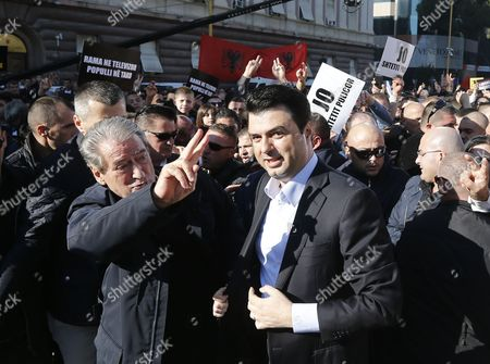 Stock Photo of Albanian Democratic Party Chairman Lulzim Basha (c) Address His Supporters As Former Democratic Leader and Former Prime Minister Sali Berisha (l) Look on As Some Thousands Albanians Protest in Tirana Albania 22 November 2014 the Protesters Are Asking Government Better Living Conditions Lowering Taxes and Changing Economic Policies Albania Tirana