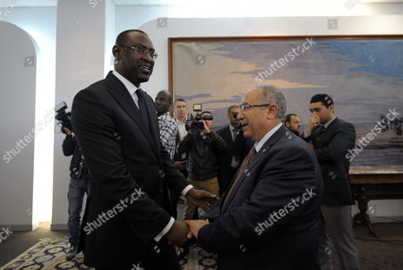 Minister of Foreign Affairs of Mali Abdoulaye Diop (l) Shakes Hands with Algerian Minister of Foreign Affairs Ramtane Lamamra (r) During the 5th Round of the Inclusive Intermalien Dialogue Between the Malian Government and Representatives of the Political-military Groups in Northern Mali Have Joined the Negotiation Process Under the Leadership of Algeria Algiers Algeria on 16 February 2015 Negotiations Between the Different Malian Parties Had Started in July 2014 and the Same Parties Were Committed to Reaching a Peace Agreement in Accordance with the Roadmap Signed During the First Round the 5th Round of the Algiers Process was Preceded by Holding Last Wednesday a Meeting Between the Malian Government and the International Mediation Team Intermalien Dialogue Chaired by the Foreign Minister and Prime Ramtane Lamamra Malian Minister Modibo Keita Algeria Algiers