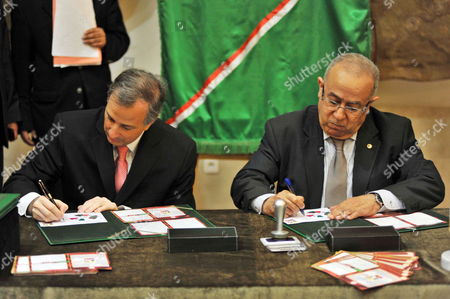 Stock Picture of Mexican Foreign Affairs Minister Jose Antonio Meade Kuribrena (l) and His Algerian Counterpart Foreign Minister Ramtane Lamamra (r) Sign a Commemorative Postage Stamp Marking 50 Years of Bilateral Relations Between the Two Countries at the Ministry of Foreign Affairs in Algiers Algeria 22 April 2015 Kuribrena is on a Three Day Visit to the North African Country to Further Develop Ties Between the Two Countries Algeria Algiers
