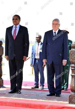President of Tanzania Jakaya Mrisho Kikwete (l) and the President of the Algerian Senate Abdelkader Bensalah (r) Stand Next Top Each Other During a Welcoming Ceremony Following Kikwete's Arrival at the Houari-boumediene International Airport in Algiers Algeria 09 May 2015 Kikwete Arrived in Algeria For a Three-day Official Visit Algeria Algiers