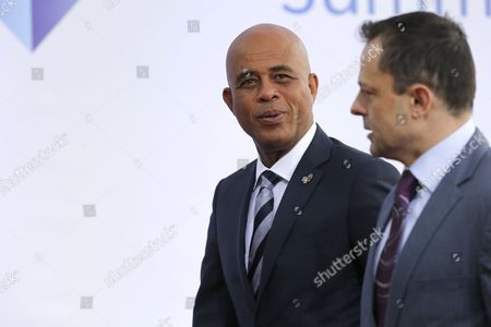 Haitian President Michel Joseph Martelly (l) Arrives For the European Union and Community of Latin American and Caribbean States (celac) Summit in Brussels Belgium 10 June 2015 the Eu-celac Summit Brings Together 61 European Latin American and Caribbean Leaders to Strengthen Relations Between Both Regions Belgium Brussels