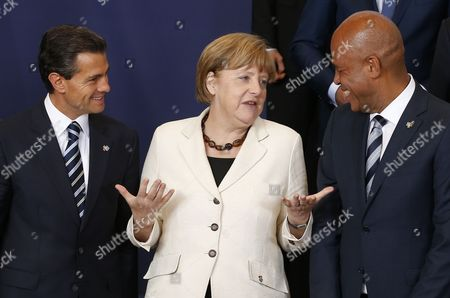 Mexican President Enrique Pena Nieto (l-r) German Chancellor Angela Merkel and Haitian President Michel Joseph Martelly Chat During a Family Picture at the European Union and Community of Latin American and Caribbean States (celac) Summit in Brussels Belgium 10 June 2015 the Eu-celac Summit Brings Together 61 European Latin American and Caribbean Leaders to Strengthen Relations Between Both Regions Belgium Brussels