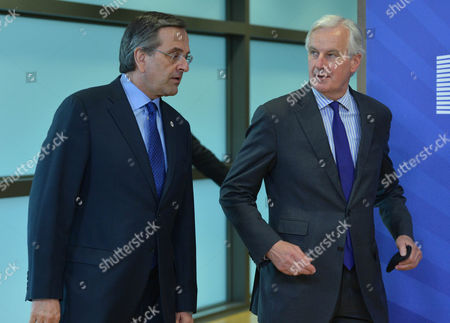 Prime Minister of Greece Antonis Samaras is Welcomed by European Union Commissioner For Internal Market and Services Michel Barnier (r) Prior to Meeting at the Eu Council Headquarters in Brussels Belgium 27 May 2014 Later Today Prime Minister of Bulgaria Plamen Oresharski Will Attend Informal European Council the Meeting of the Heads of States and Government Will Discuss the Results of the European Parliament's Elections and the Latest Developments in Ukraine Following the Presidential Elections Belgium Brussels