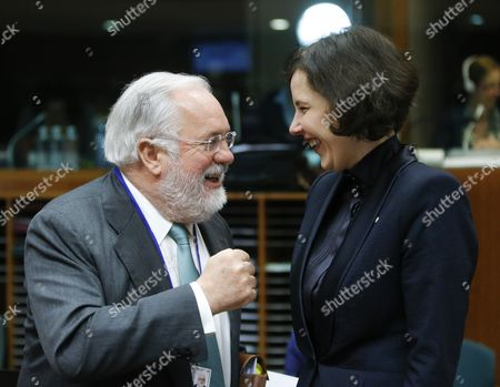 Eu Commissioner For Climate Action and Energy Miguel Arias Canete (l) Talks with Chair of the Eu Energy Council Dana Reizniece-ozola (r) at the Start of an Energy Council in Brussels Belgium 05 March 2015 Belgium Brussels