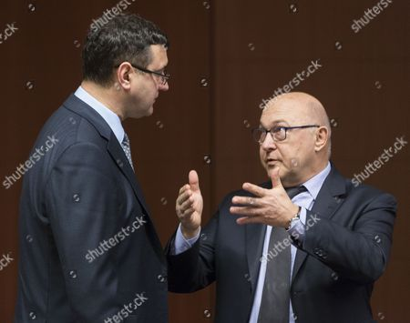 Latvian Finance Minister Janis Reirs (l) and French Finance Minister Michel Sapin (r) Talk Prior an Eurogroup Meeting of Finance Ministers at Eu Council Headquarters in Brussels Belgium 16 February 2015 the Eurogroup Finance Ministers Meet to Discuss on a New Bailout Deal with Greece and Finding Common Ground with Greek Finance Minister Yanis Varoufakis who is Seeking to Renegotiate His Country's Bailout Because of the Painful Austerity Measures It is Associated with Belgium Brussels