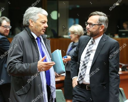 Belgian Foreign Minister Didier Reynders (l) and Michael Roth (r) the New German Government's Minister of State For European Affairs Speak with Each Other at the Start of a European Affairs Council Meeting at the Eu Headquarters in Brussels Belgium 13 May 2014 Belgium Brussels