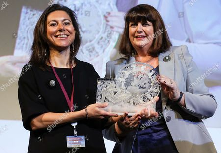 Third Placed Ana Maiques Valls Chief Executive Officer of Starlab From Spain (l) and European Commissioner For Research Innovation and Science Maire Geoghegan-quinn (r) Pose with the Prize of the 'Women Innovators 2014' on the Second European Innovation Convention in Brussels Belgium 10 March 2014 the European Commission Awards the Second Edition of the Eu Prize For Women Innovators to Three Women who Have Achieved Outstanding Innovations and Brought Them to Market Belgium Brussels