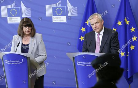 European Commissioner For Research Innovation and Science Maire Geoghegan-quinn of Ireland and European Commission Responsible For the Economic and Monetary Affairs and the Euro Olli Rehn of Finland (r) Speak During a Press Briefing to Present the Commission's Points on Innovation Reforms to Sustain Economic Recovery at the Eu Commission Headquarters in Brussels Belgium 10 June 2014 the European Commission Has Highlighted the Importance of Research and Innovation (r&i) Investments and Reforms For Economic Recovery in the European Union on 10 June and Made Proposals to Help Eu Member States Maximise the Impact of Their Budgets at a Time when Many Countries Still Face Spending Constraints Belgium Brussels