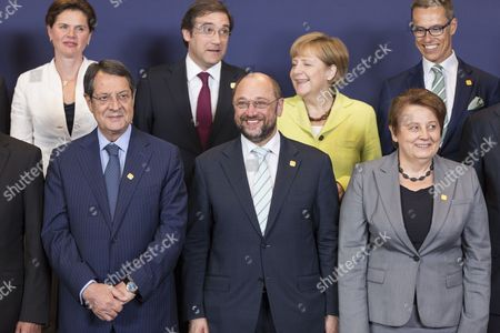 (l-r) Slovenian Prime Minister Alenka Bratusek Cypriot President Nicos Anastasiades Portuguese Prime Minister Pedro Passos Coelho European Parliament President Martin Schulz German Chancellor Angela Merkel Latvian Prime Minister Laimdota Straujuma and Finnish Prime Minister Alexander Stubb Pose For a Family Photo During an Informal Dinner of Heads of States in Brussels Belgium 16 July 2014 the Leaders of the European Unions Member States Are Expected to Appoint the New Foreign Policy Chief and the Next President of the European Council Belgium Brussels