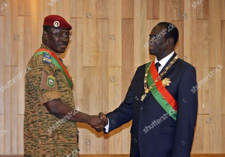 Michel Kafando (r) Shakes Hands with Lieutenant-colonel Isaac Zida (l) After Being Sworn in As the Country's Transitional President in Ouagadougou Burkina Faso 18 November 2014 Former Foreign Minister Michel Kafando was Sworn in As Burkina Faso's Transitional President Following Weeks of Uncertainty and Will Lead the Country Until Elections November 2015 President Blaise Compaore Stepped Down After Massive Protests in the Capital Against His Attempt to Extend His 27-year Rule in Burkina Faso in October Burkina Faso Ouagadougou